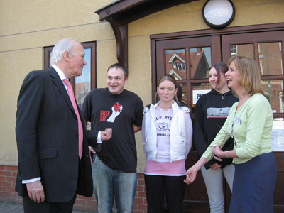 Ming Campbell with staff and residents at the Foyer in Abingdon
