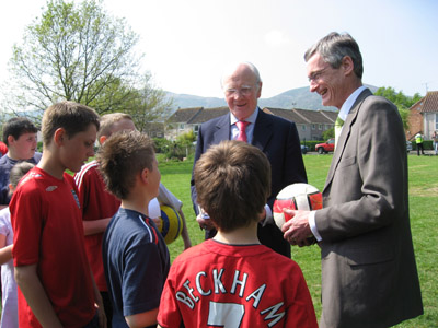Ming and Richard Burt with children at a local football club in Great Malvern